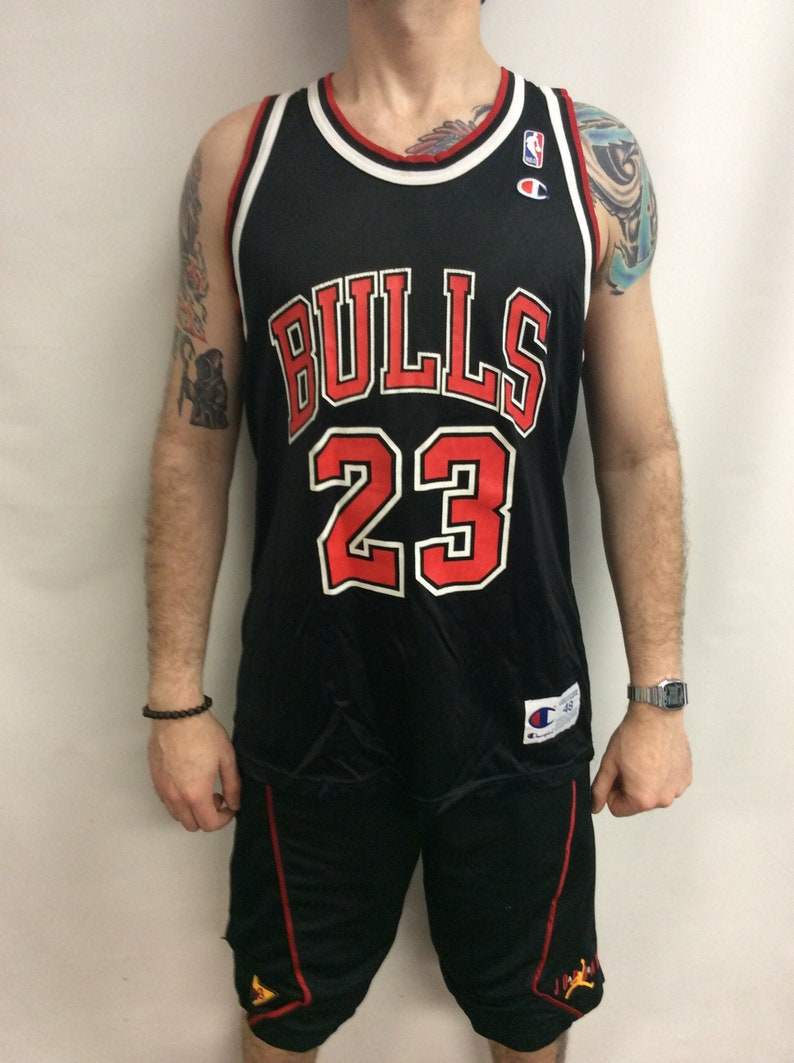 super popular c51f3 6d572 Vintage 90's Chicago Bulls Basketball Michael Jordan #23 Black & Red  Champion NBA Jersey (Size 48)