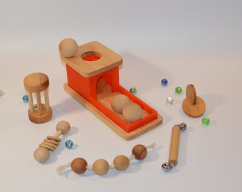 A Set of Rattles and Montessori Object Permanence Box with Tray and 3 Wooden Balls. Set of 6 toys.