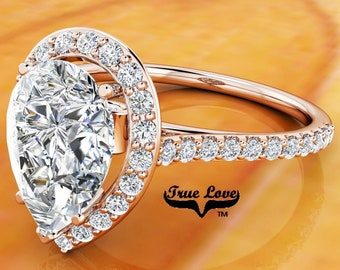 Moissanite Pear Shaped Engagement Ring Trek Quality #1 14 kt. Rose Gold Halo and Side Moissanites  #6847