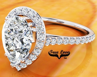 Moissanite Pear Shaped Engagement Ring Trek Quality #1 14 kt. White Gold Halo and Side Moissanites  #6846