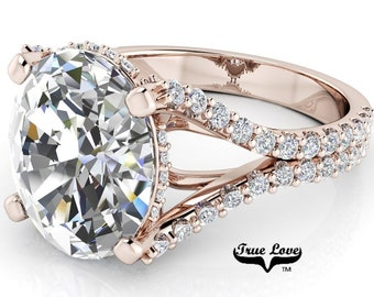 Moissanite Engagement ring Trek Quality #1, VVS clarity, D-E colorless or G-H near colorless set in 14kt Rose gold #8369.