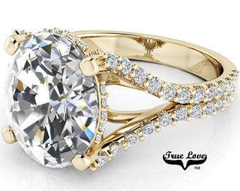 Moissanite Engagement ring Trek Quality #1, VVS clarity, D-E colorless or G-H near colorless set in 14kt Yellow gold #8368.