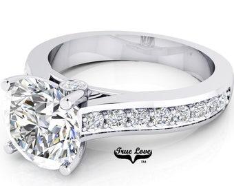 Moissanite Engagement Ring Trek Quality #1  D-E Color VVS Clarity , Side Moissanites  Brand: True love 14 kt White Gold.  #6941
