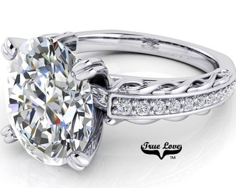 Oval Cut Moissanite Engagement Ring  Trek Quality #1, D-E Colorless or G-H near colorless VVS Clarity set in 14 kt White Gold  #6806