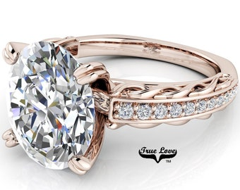 Oval Cut Moissanite Engagement Ring  Trek Quality #1, D-E Colorless or G-H near colorless VVS Clarity set in 14 kt Rose Gold  #6808