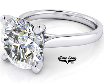Round Brilliant Cut Moissanite Engagement Ring Trek Quality #1 VVS Clarity D-E colorless or G-H Near Colorless set in 14 kt White Gold #6837