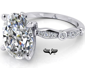Moissanite Engagement Ring Trek Quality #1 D-E Colorless or G-H Near Colorless, with Side Moissanites set in 14kt White Gold #6809