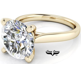 Round Brilliant Moissanite Engagement Ring Trek Quality #1 VVS Clarity D-E colorless or G-H Near Colorless set in 14 kt Yellow Gold #6838