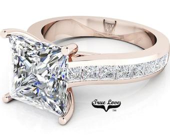 Moissanite Engagement Ring Trek Quality #1  D-E Color VVSClarity , Side Moissanites  Brand: True love 14 kt Rose Gold.  #6925
