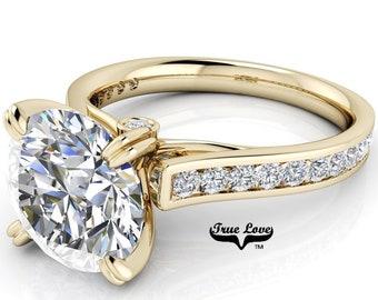 Round Trek Brilliant Cut Moissanite Trek Quality#1 D-E Color  VVs Clarity Engagement Ring set in 14kt Yellow Gold #7563