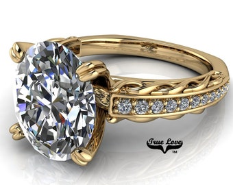 Oval Cut Moissanite Engagement Ring  Trek Quality #1, D-E Colorless or G-H near colorless VVS Clarity set in 14 kt Yellow Gold  #6807