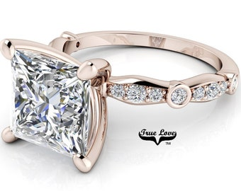 Moissanite Engagement Ring Trek Quality #1 D-E Colorless or G-H Near Colorless with Side Moissanites set in 14kt Rose Gold #6783
