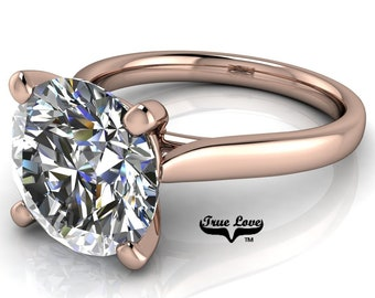 Round Brilliant Cut Moissanite Engagement Ring Trek Quality #1 VVS Clarity D-E colorless or G-H Near Colorless set in 14 kt Rose Gold #6839