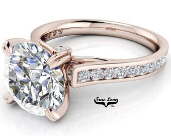 Round Trek Brilliant Cut Moissanite Trek Quality#1 D-E Color  VVs Clarity Engagement Ring set in 14kt Rose Gold #7564