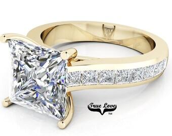 Moissanite Engagement Ring Trek Quality #1  D-E Color VVS Clarity , Side Moissanites  Brand: True love 14 kt Yellow Gold.  #6964