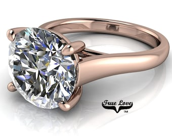 Round Brilliant Cut Moissanite Engagement Ring VVS clarity D-E colorless or G-H near colorless set in 14 kt Rose Gold #7004