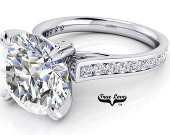 Round Brilliant Cut Moissanite Engagement ring Trek Quality #1 D-E Colorless or G-H Near Colorless set in 14kt White gold #6721