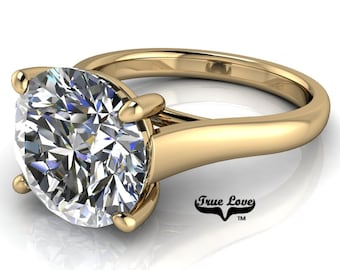 Round Brilliant Cut Moissanite Engagement Ring VVS clarity D-E colorless or G-H near colorless set in 14 kt Yellow Gold #7016