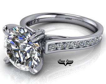 Round Trek Brilliant Cut Moissanite Trek Quality#1 D-E Color  VVs Clarity Engagement Ring set in 14kt White Gold #7562