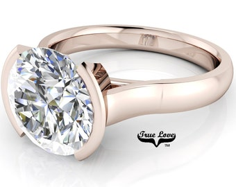 Moissanite Solitare Engagement Ring Trek Quality Number One D-E or G-H Color VVS CLarity in 14 kt Rose gold. #7007