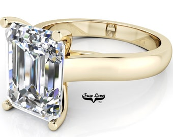 Moissanite Emerald cut Trek Quality#1 D-E Color  VVS1-2 Clarity Brand:True Love Engagement Ring 14 kt Yellow Gold.#7012