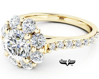 Moissanite Engagement Ring, Trek Quality #1 D-E colorless or G-H near colorless, VVS clarity set in 14kt Yellow Gold  #7030A