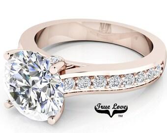 Moissanite Engagement Ring Trek Quality #1  D-E Color VVSClarity , Side Moissanites  Brand: True love 14 kt Rose Gold.  #6923