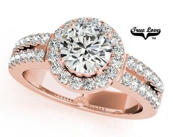 Moissanite Engagement Ring ,Trek Quality #1 D-E Color  VVS Clarity,One Carat Center Halo and side Stones 14kt Rose Gold Split Shank #7235