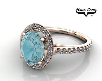 14 kt. Rose Gold True Love Oval Blue Zircon with Halo and side stones  Engagement Ring. #7130