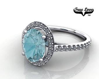 14 kt. White Gold True Love Oval Blue Zircon with Halo and side stones  Engagement Ring. #7129