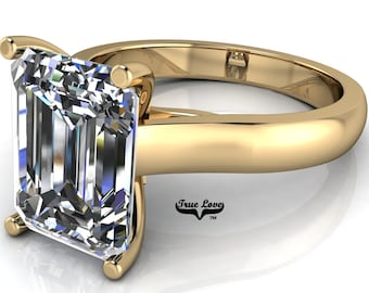 Moissanite Emerald cut Trek Quality#1 D-E Color  VVS1-2 Clarity Brand:True Love Engagement Ring 14 kt Yellow Gold.#7012