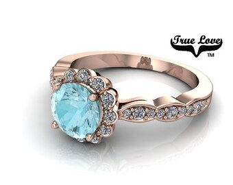 14 kt. Rose Gold Genuine Round 5 mm .72 Carat  Blue Zircon  with .27 carat tw  Halo & Side Moissanites  Engagement Ring. #7114