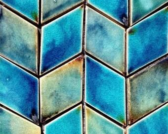 Diamond-Shaped Handmade Ceramic Wall Tiles In Vibrant Blues