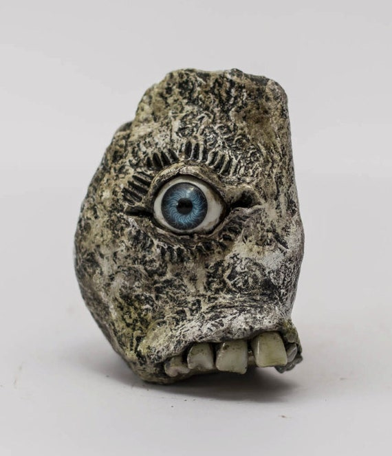 Spooquish rock monsters creepy sculpture with eyes and teeth