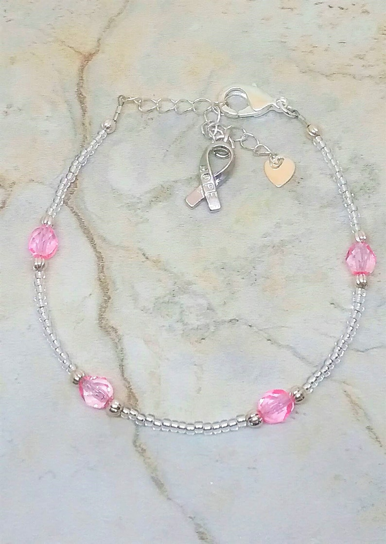 Silver-tone and pink anklet with heart and hope ribbon charm. Breast cancer awareness ankle bracelet