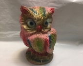 Chalkware bank posing as a neon owl. Carnival prize from yesteryear