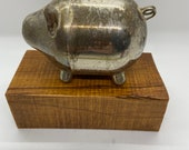 Vintage silver plated piggy bank.