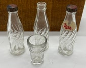 vintage Coke glass and some miniature Pepsi bottles - 4 item lot