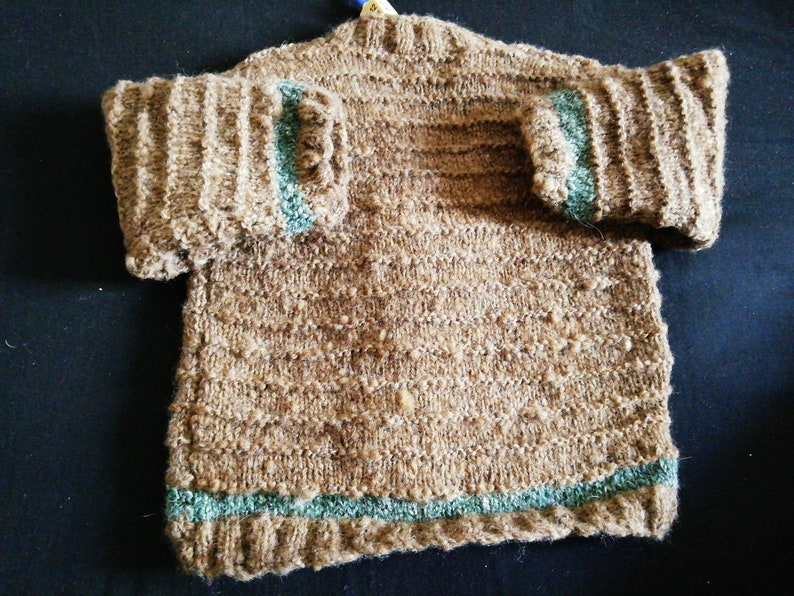 in Home Spun Wool To fit a child aged 6-12 months old. Hand Knitted cardigan