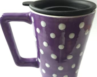 Ceramic travel mug hand decorated purple with white polka dots