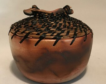 Saggar-fired ceramic vessel with pine needles