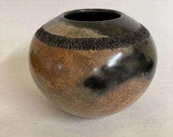 Pit-fired ceramic vessel
