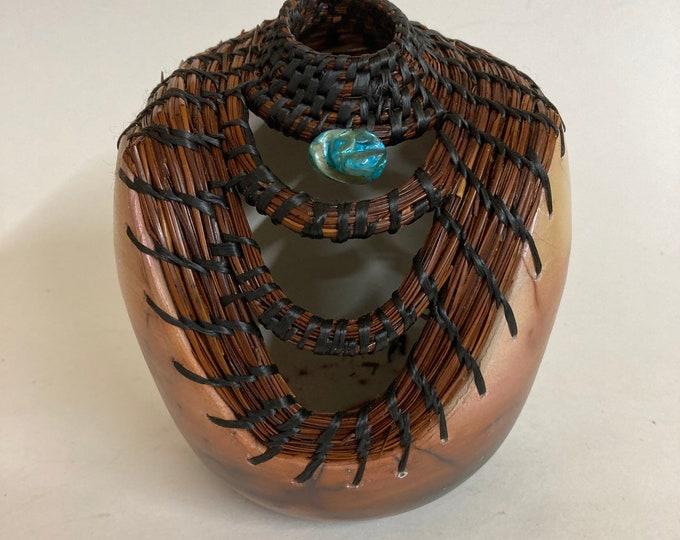 Saggar vessel with pine needles