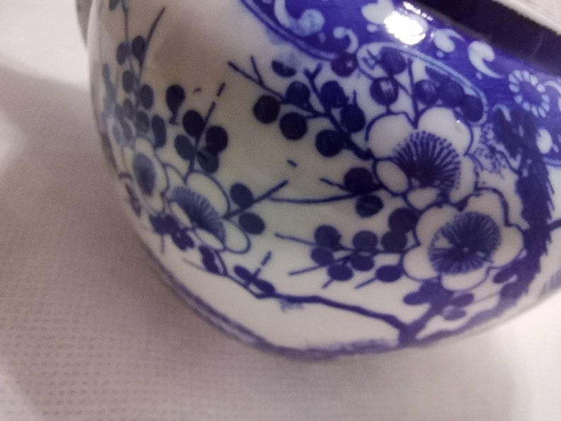 No markings. Blue and white Chinese design teapot Wicker bamboo handle