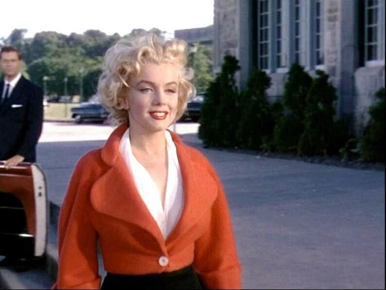 684f808362d39a orange de 1953 Marilyn Monroe recadrée veste