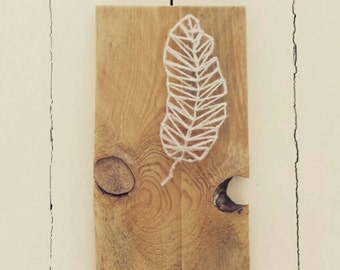 Wooden board with feather string art