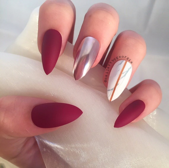 Matte berry red stilettos with marble and chrome false nails from ...