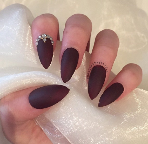 Burgundy matte stiletto nails with rhinestone and gold bead | Etsy