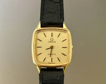 OMEGA Vintage Lady Watch in 18kt solid gold with box and movement booklet