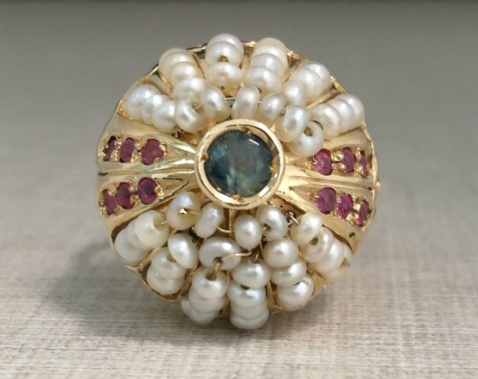 Vintage 12kt Gold Ring with sapphire, rubies and pearls.